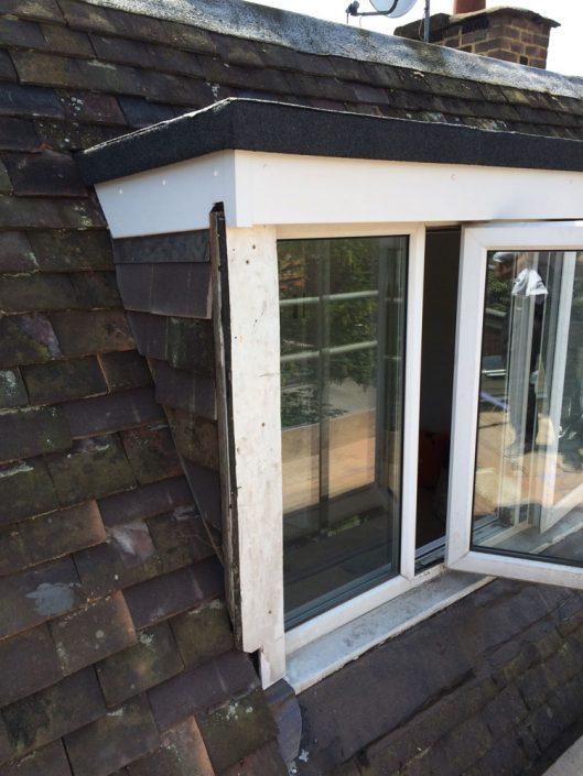 Rebuild dormer window and re-roof