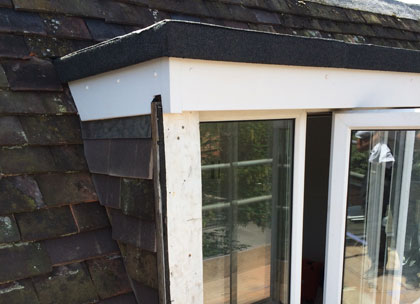Rebuild dormer window and re-roof